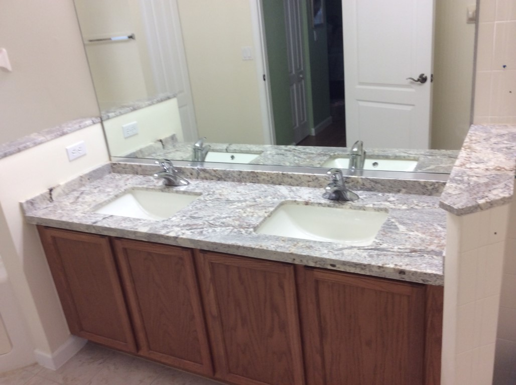 Granite bathroom countertops best granite for less for Small bathroom countertop ideas